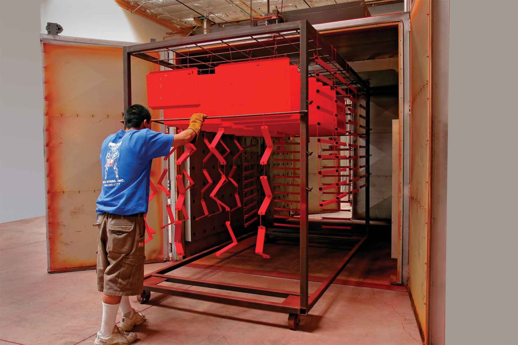 Products being powder coated in a powder coating oven